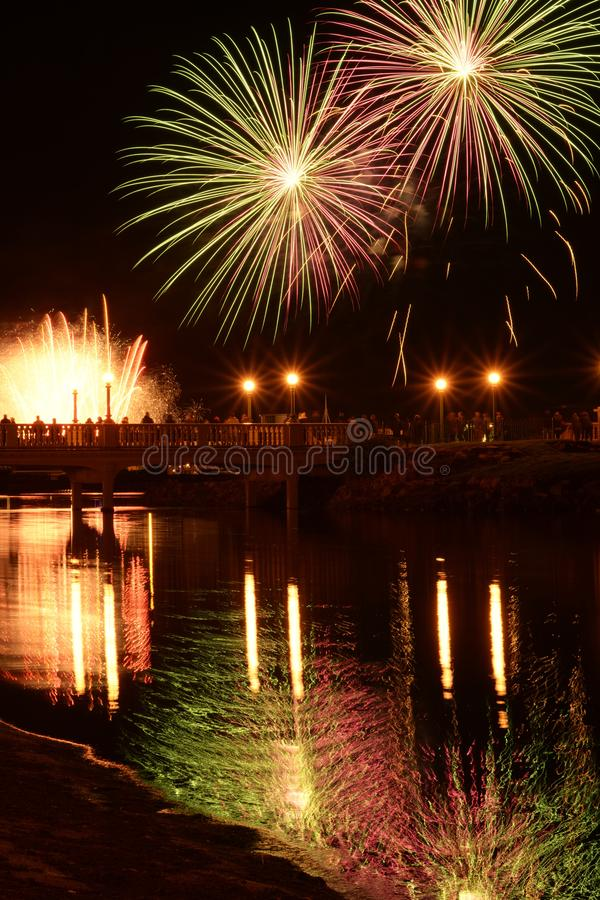 British fireworks show on display in Southport. Fireworks show in southport United Kingdom on display. People watching on the bridge stock images