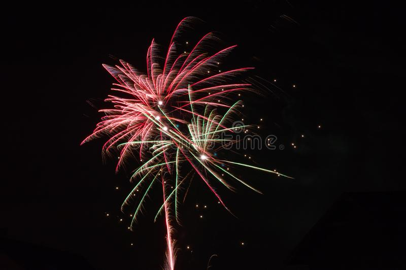 Fireworks in the sky over the night city stock photos