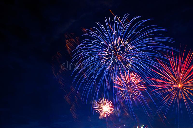 Fireworks in sky twilight. Fireworks display on dark sky background. Independence Day, 4th of July, Fourth of July or New Year royalty free stock photos