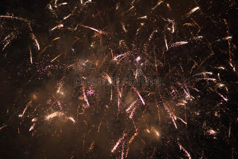 Fireworks. Stars and shiny fireworks on red background stock image