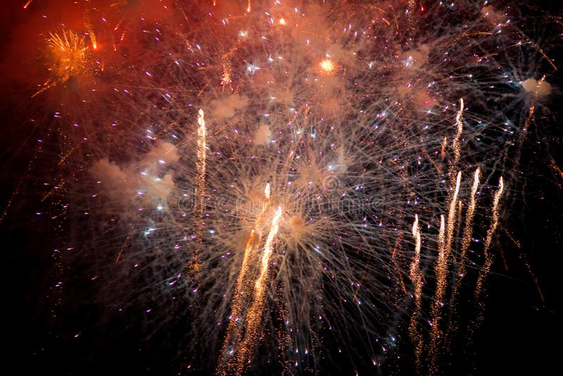 Fireworks. Stars and shiny fireworks on red background royalty free stock images