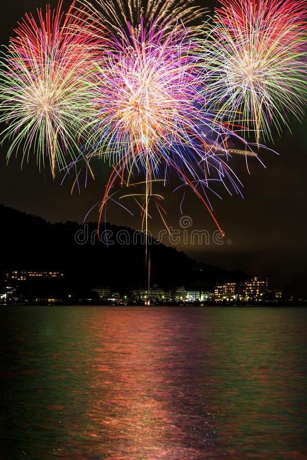 Fireworks. There is also a symbol of celebrations, fireworks is summer tradition in Japan. It is the fireworks seen from the shores stock images