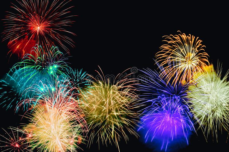 Fireworks of various color bursting against on black background royalty free stock photo