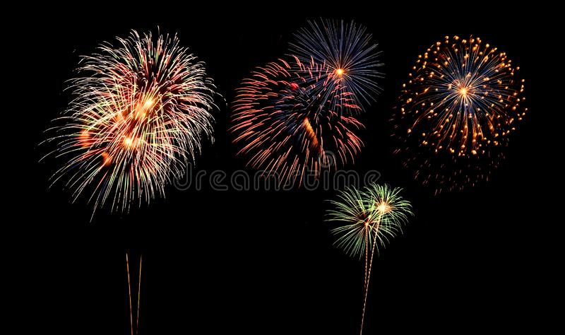 Fireworks of various colors and shapes royalty free stock photography