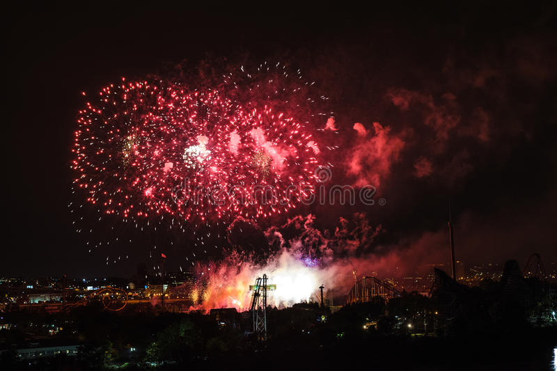 Fireworks view from the Jacques-Cartier Bridge. July 26th, 2014 - Montreal, Canada. Loto-Quebec Fireworks of La Ronde view from the Jacques-Cartier Bridge stock photography