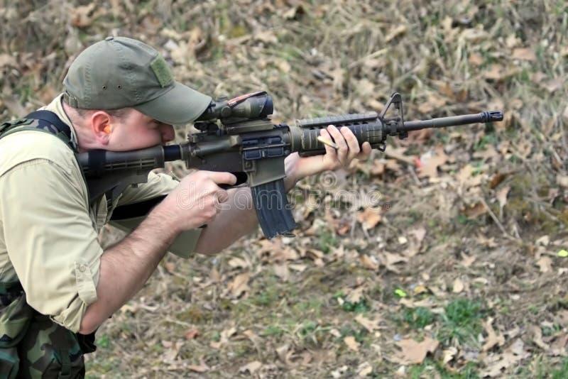 Firing Assault Rifle royalty free stock photography