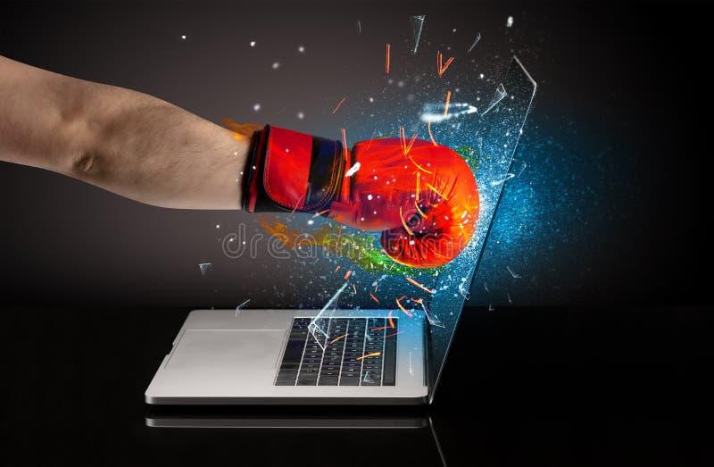 Firing hand breaking laptop screen glass. Firing hand hitting strongly laptop screen glass royalty free stock photography