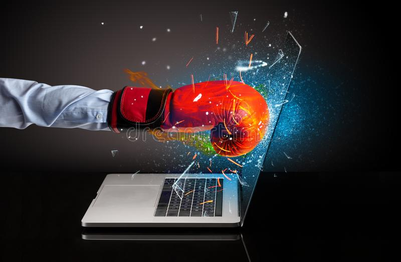 Firing hand breaking laptop screen glass. Firing hand hitting strongly laptop screen glass stock photography
