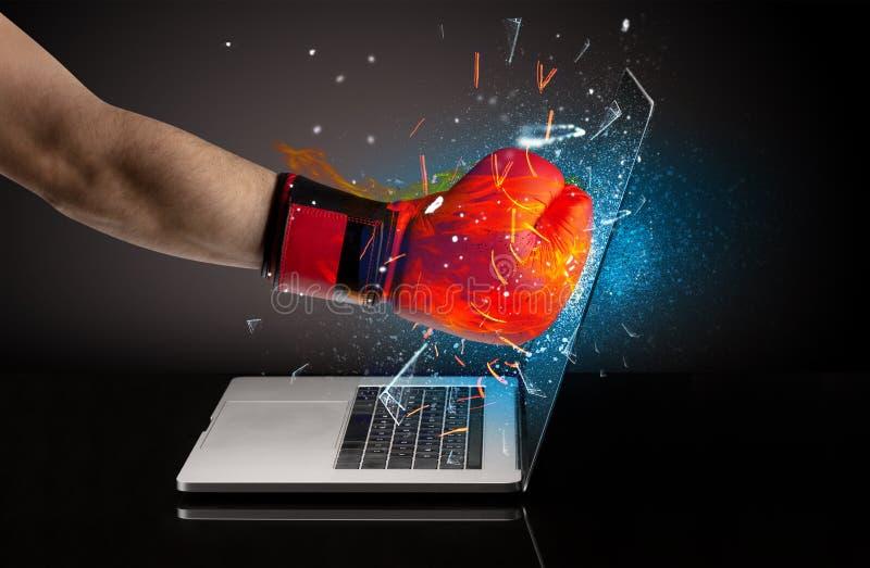 Firing hand breaking laptop screen glass. Firing hand hitting strongly laptop screen glass royalty free stock photos