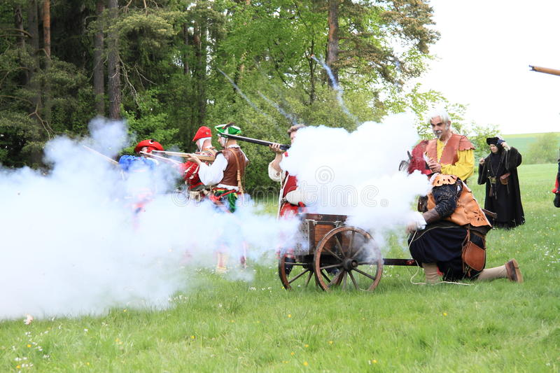 Firing from machine-gun. Landsknechts shooting with arkebusa and machine-gun on meadow at Spring Landsknecht Camping at Bohdalov (Czech Republic, the 10th of May royalty free stock images