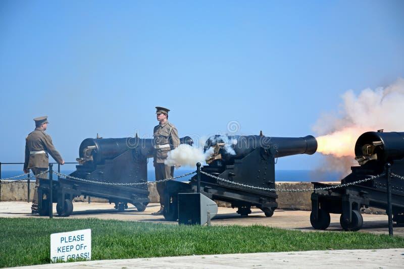 Firing the Noon Gun, Valletta, Malta. Military personnel firing The Noon Gun in the Saluting Battery, Valletta, Malta, Europe stock photo