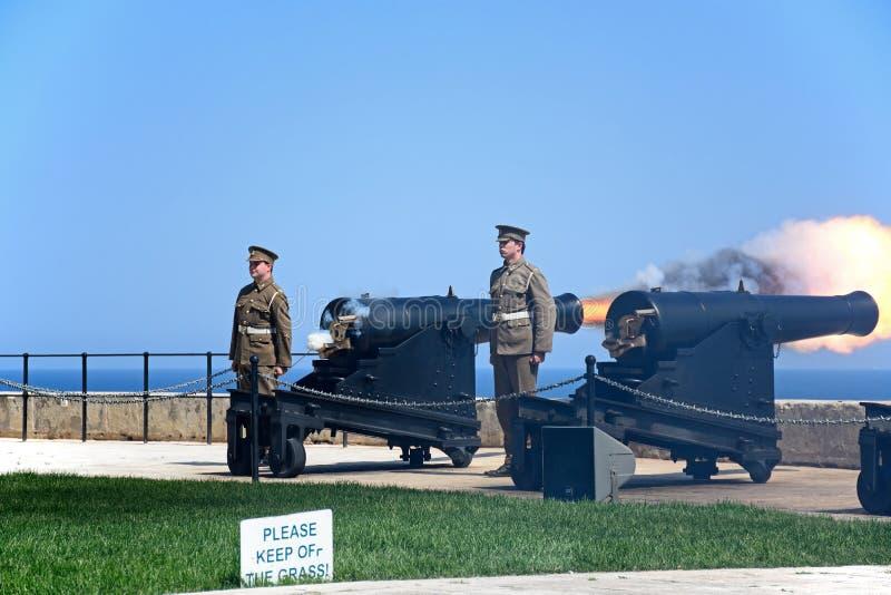 Firing the Noon Gun, Valletta, Malta. Military personnel firing The Noon Gun in the Saluting Battery, Valletta, Malta, Europe stock photos