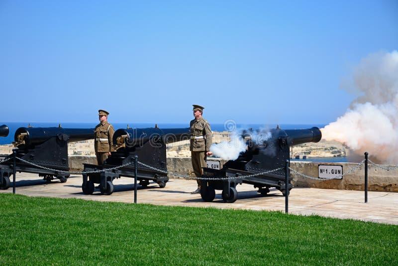 Firing the Noon Gun, Valletta, Malta. Military personnel firing The Noon Gun in the Saluting Battery, Valletta, Malta, Europe royalty free stock photography