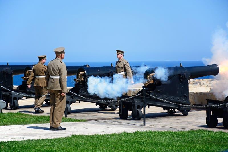 Firing the Noon Gun, Valletta, Malta. Soldiers firing cannons for the Noon Gun in Upper Barrakka Gardens, Valletta, Malta, Europe royalty free stock photo