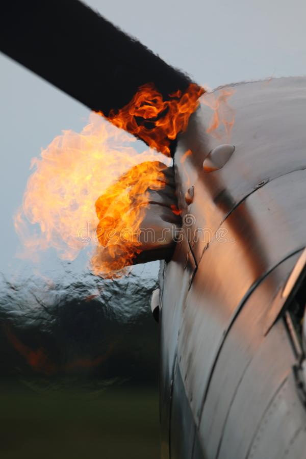 Firing up for take off. Fire, flame, flames, heat, hot, jet, engine, fighter, plane, aircraft, aeroplane, propeller, exhaust, war, vintage, spitfire, ww2 stock photography
