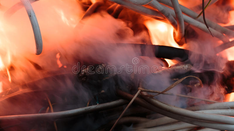 Firing wire in fire. Wires on fire. Firing winding insulation of electrical wiring in the fire close-up royalty free stock images