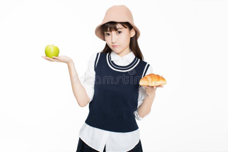 Firl en voedsel en fruit royalty-vrije stock afbeeldingen