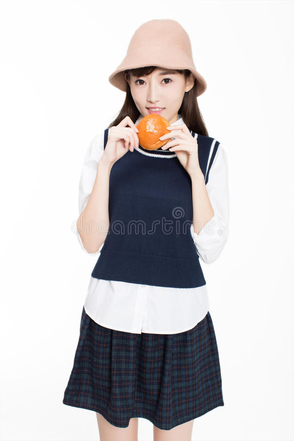 Firl and food and fruit. Pretty c hinese girl, she bread and fruit in the room. In the white background royalty free stock image