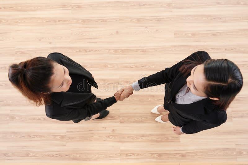 Firm Handshake of Businesswomen stock photography