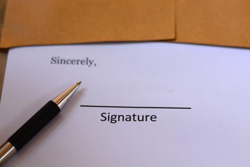 Firma con la penna immagine stock libera da diritti