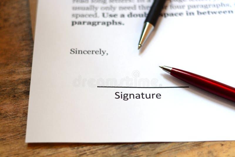 Firma con la penna fotografie stock