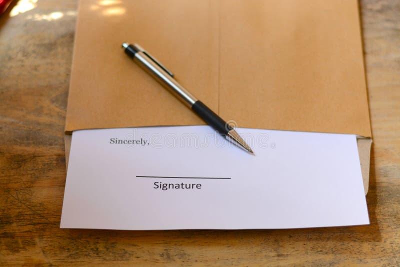 Firma con la penna fotografia stock
