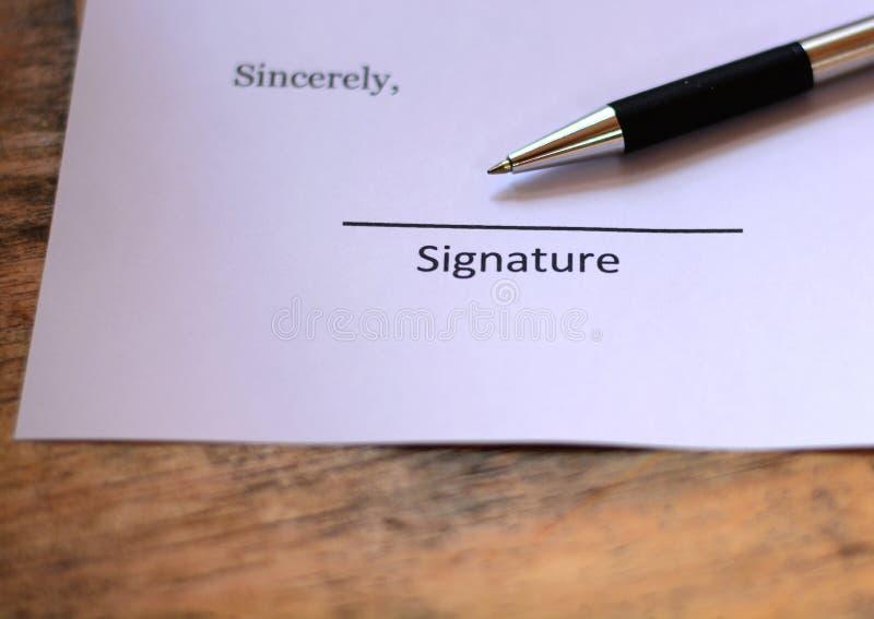 Firma con la penna immagini stock