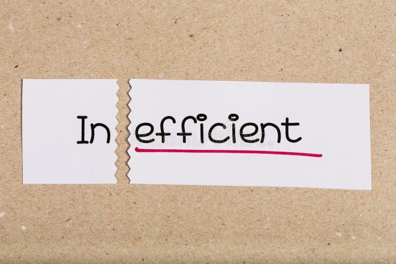 Firme con ineficaz de la palabra dado vuelta en effcient foto de archivo