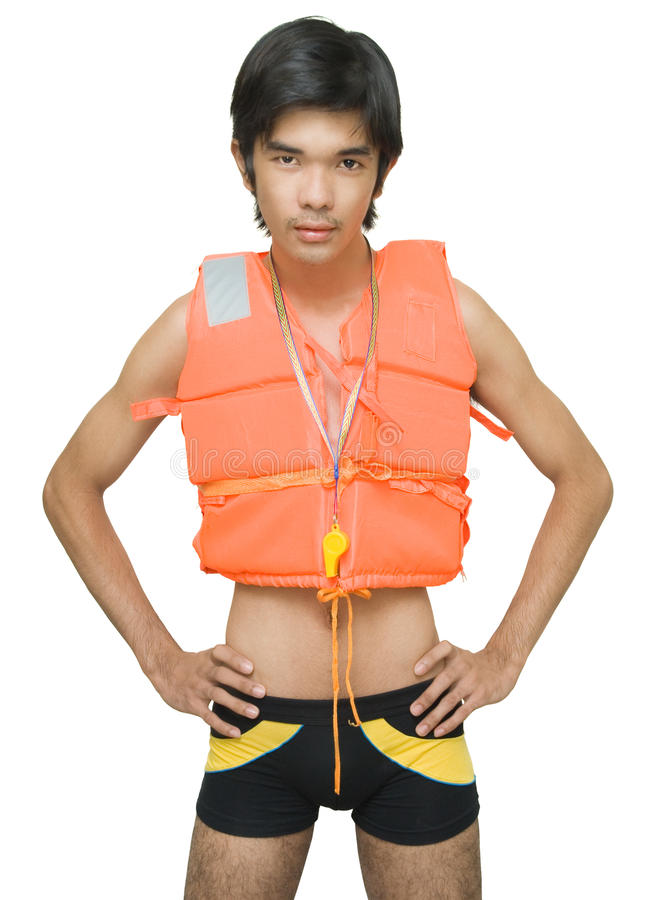 Firmly standing peering lifeguard. Firmly standing Asian lifeguard in life vest with whistle and hands on hips peering attentively at the camera. Isolated over royalty free stock image