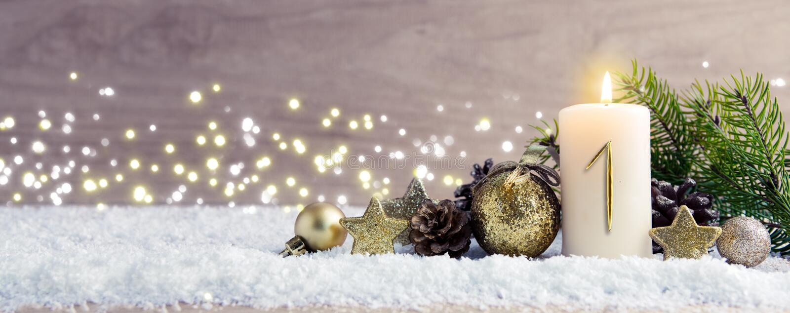 First Advent. Christmas background with Advent candle and golden decoration. royalty free stock photos