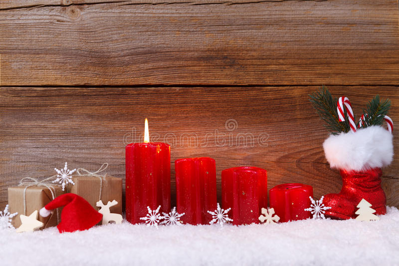 First advent. Christmas decoration with candles for advent season one candle burning royalty free stock images