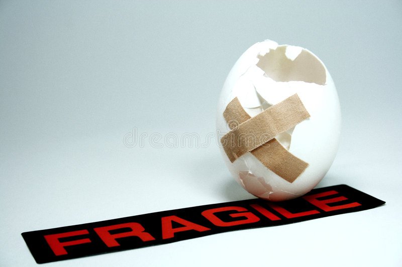 First aid. Injured egg with a fragile label stock photography