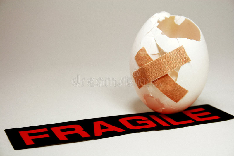 First aid. Injured egg with a fragile label royalty free stock image
