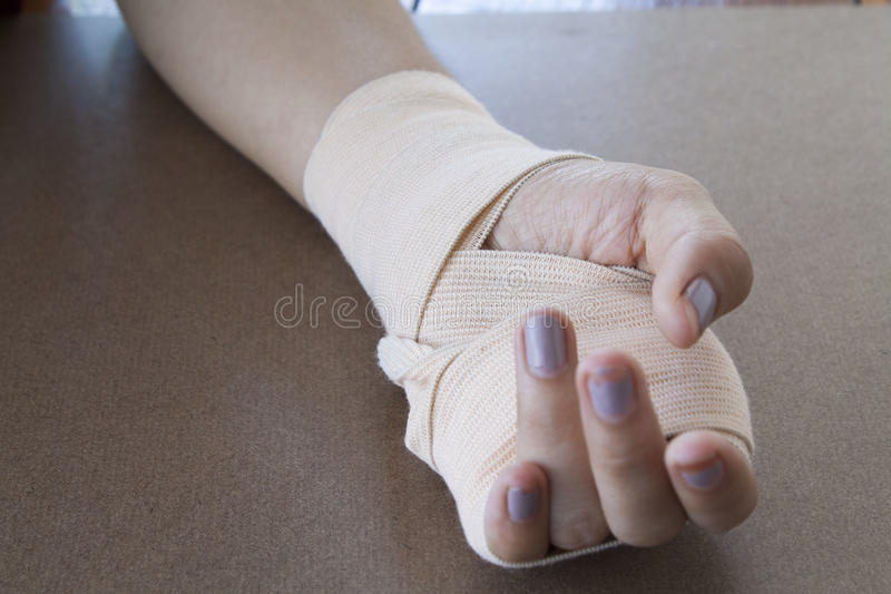 First aid accident wrist with liniment. Background royalty free stock photography