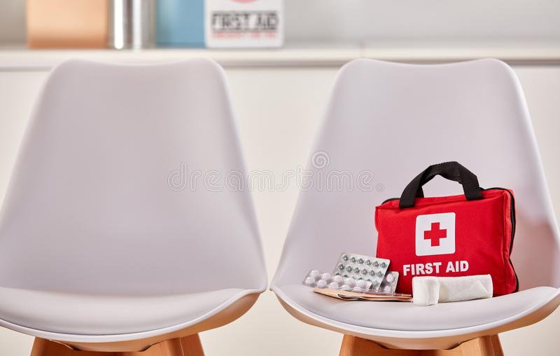 First aid kit in the waiting room of a hospital royalty free stock photo