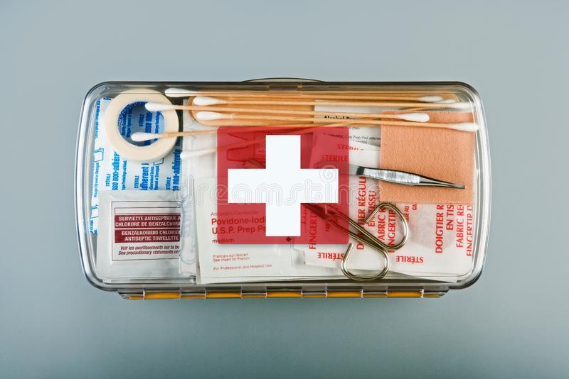 First aid kit packed with medical supplies on grey background. Organized first aid kit packed with emergency medical supplies on grey background royalty free stock photography