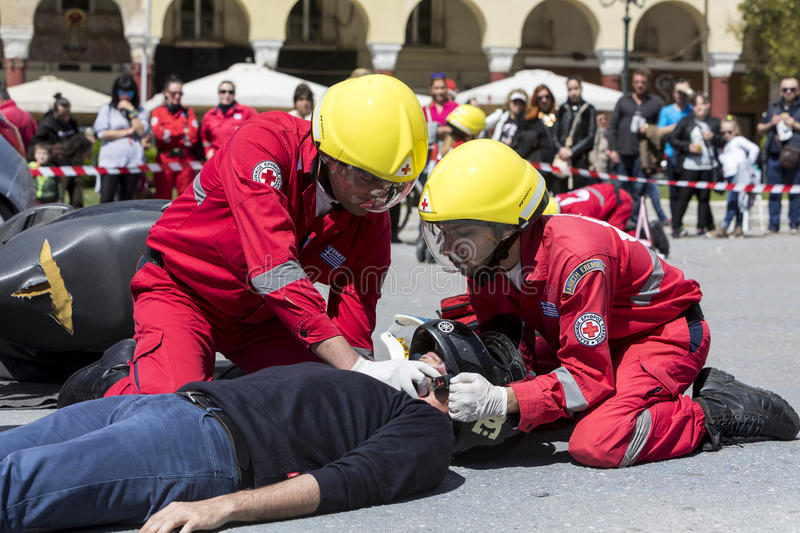First aid, victim liberation in an car accident. Thessaloniki , Greece - April 9, 2017: First aid, victim liberation in an car accident and helmet removal royalty free stock photo
