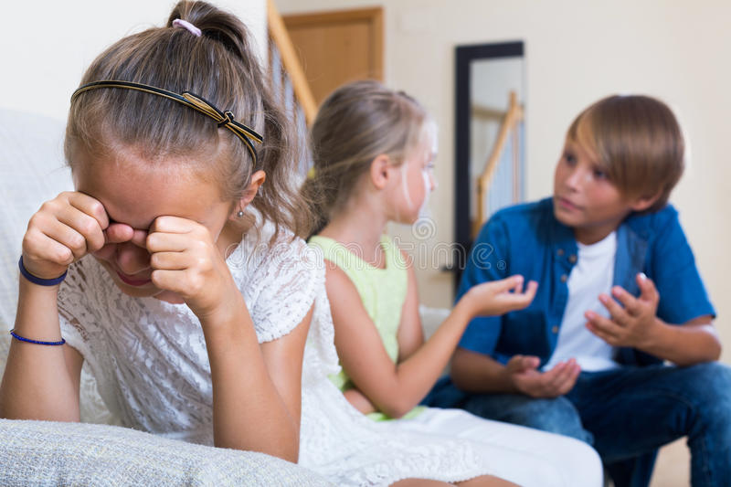 First amorousness: girl and couple of kids apart stock image