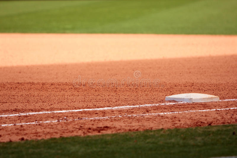 First Base Featured In Empty Baseball Field Stock Photo