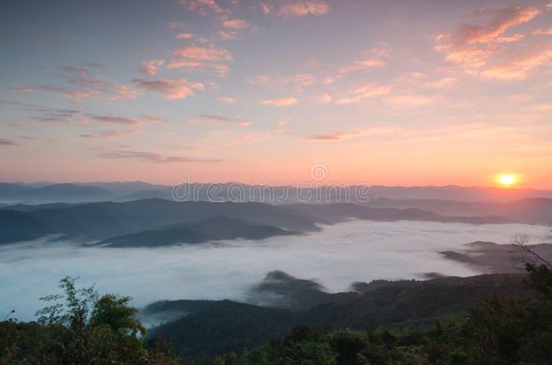 The first beams of a rising sun shine mountains. Thailand stock photos
