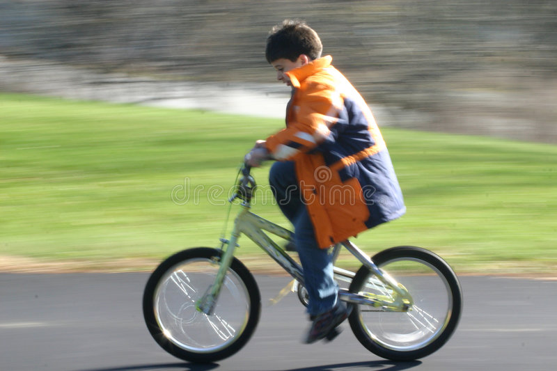 First bike solo in motion stock photography
