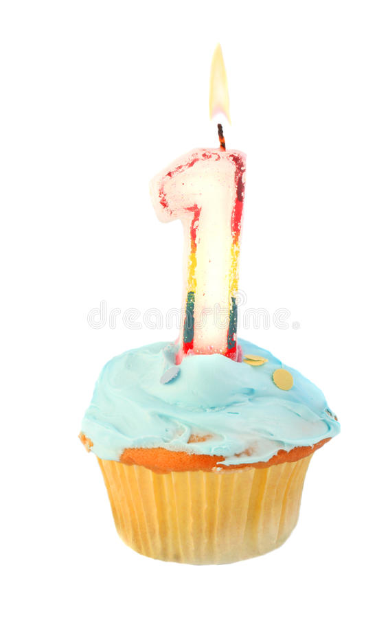 First birthday. Cupcake with blue frosting on a white background stock photo