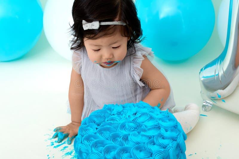 First birthday cake smashing royalty free stock photography