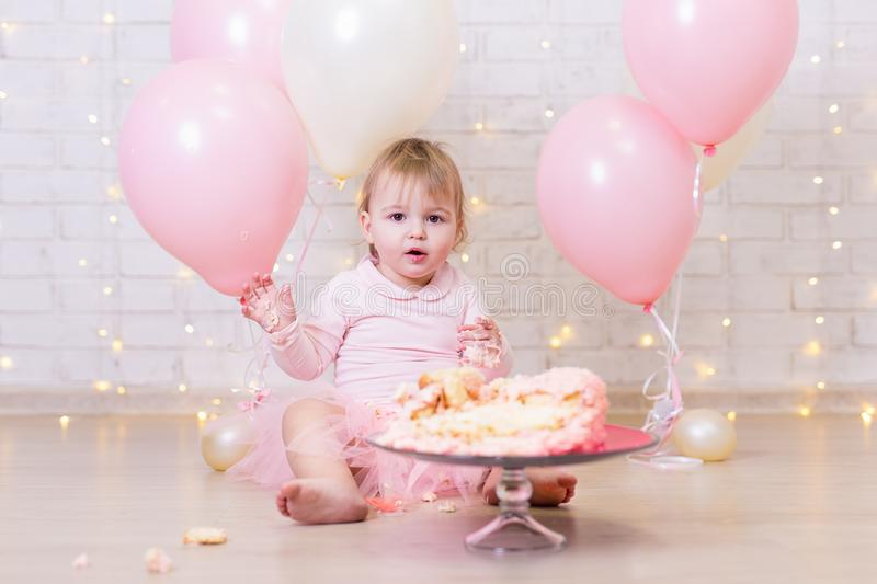 First birthday celebration - funny little girl with smashed cake stock photography