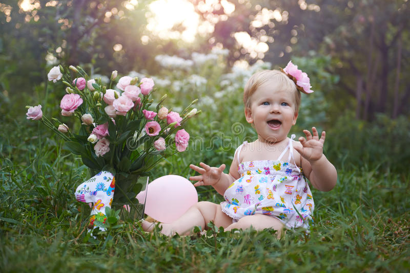 First birthday celebration on a warm summer evening.  stock photo