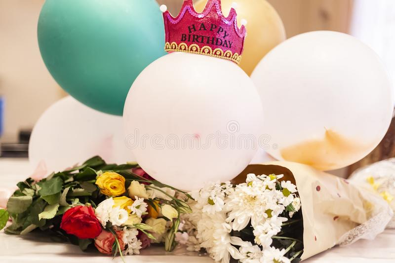 First birthday concept. Birthday decorations. Bouquet of flowers and balloons with a crown. First birthday concept. Birthday decorations ready to party. Bouquet royalty free stock images