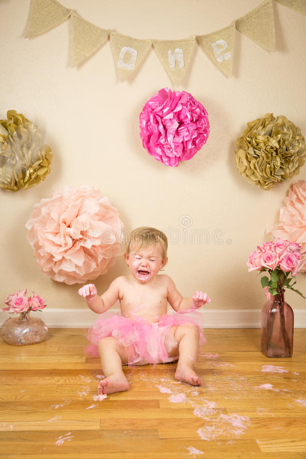 First Birthday. Little girl 1st birthday cakesmash royalty free stock images