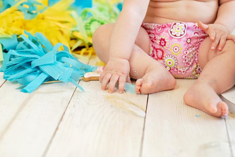 First birthday smash the cake. cream on legs royalty free stock images