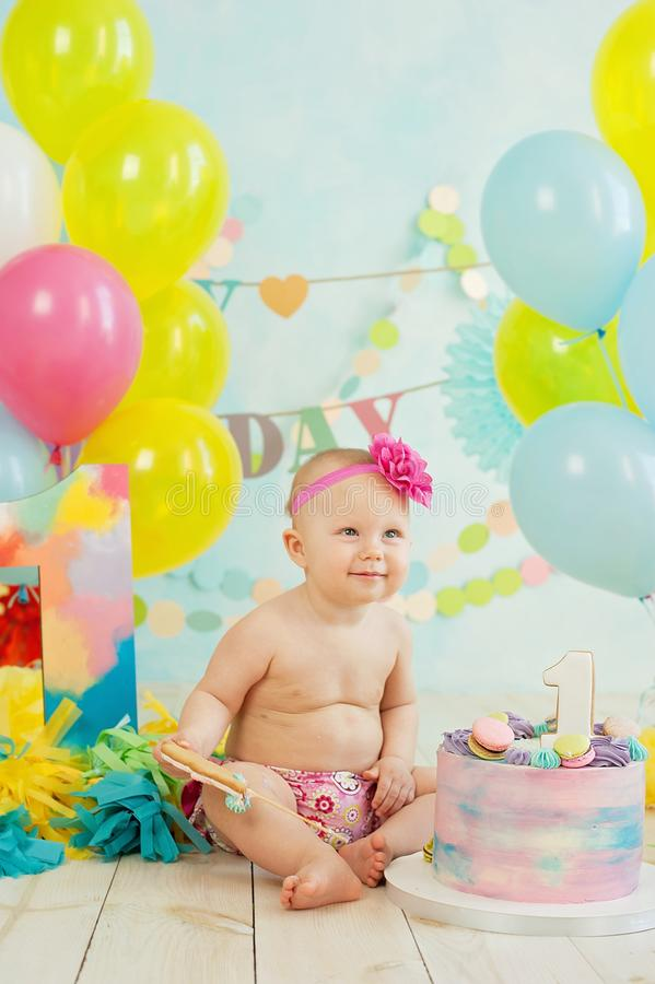 First birthday smash the cake. cream on legs. Festive background decoration for birthday with cake, Cake Smash first year concept. birthday greetings, baby stock photo