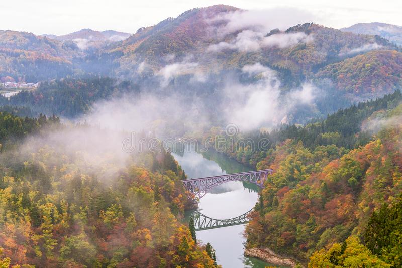 First bridge and Tadami river in autumn season stock photography